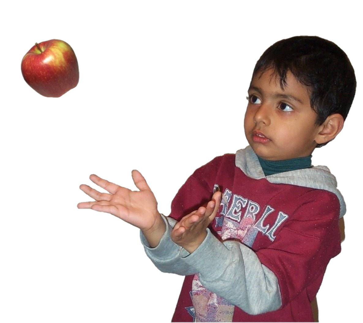 Boy catching apple.jpg