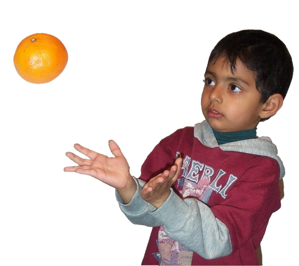 Boy catching orange.jpg