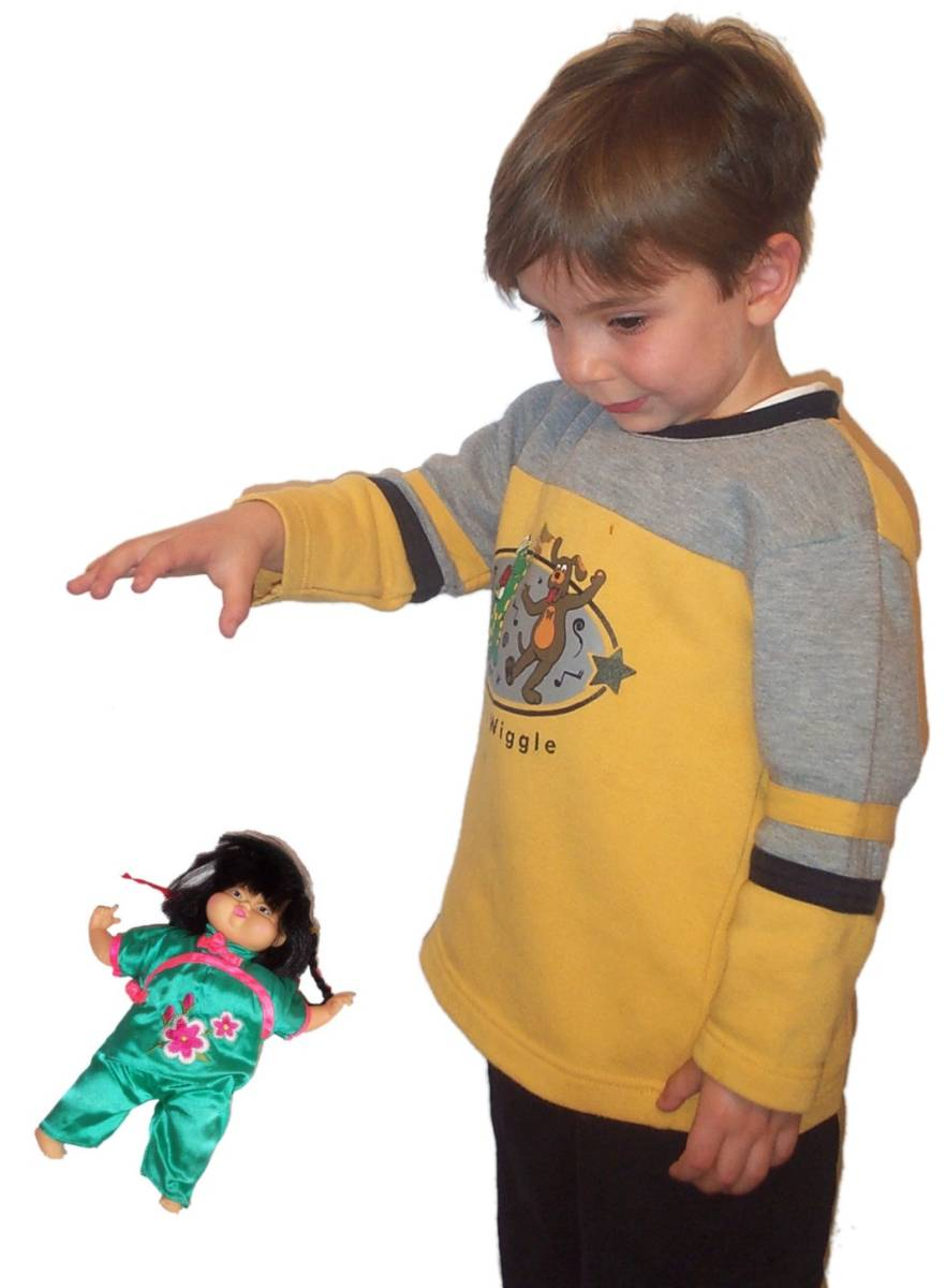 Boy dropping doll.jpg