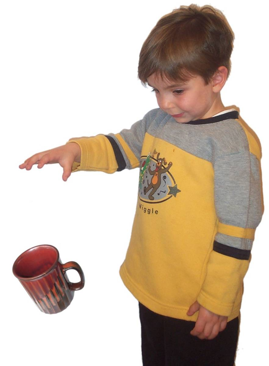 Boy dropping mug.jpg
