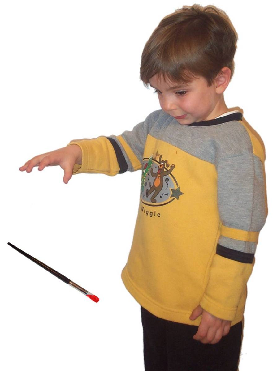 Boy dropping paintbrush.jpg