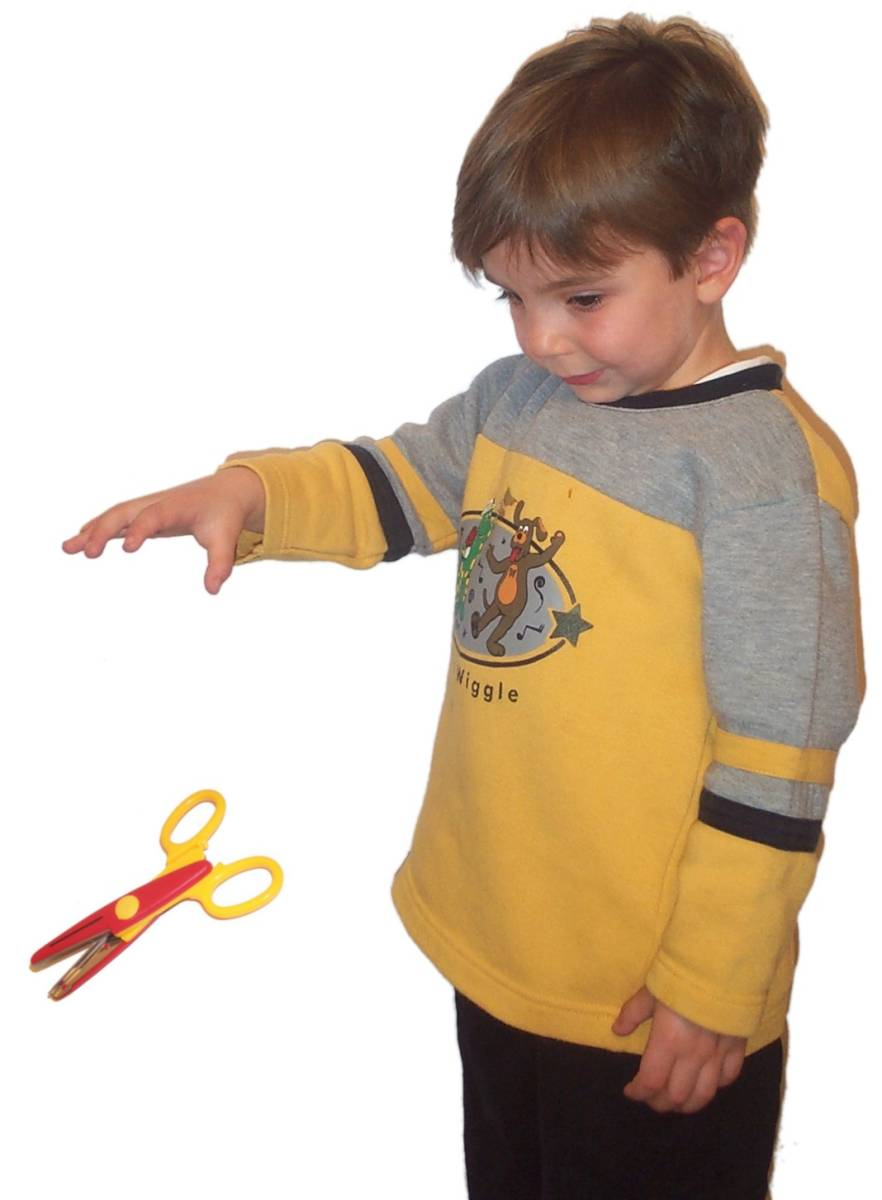 Boy dropping scissors.jpg