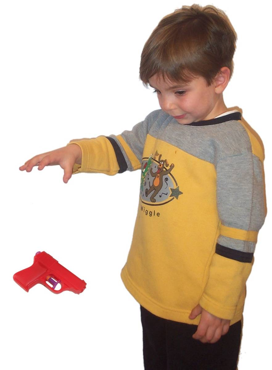 Boy dropping water pistol.jpg