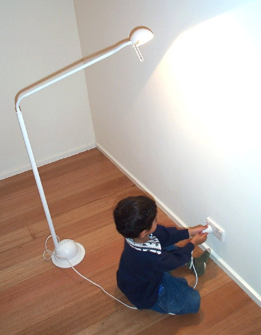 Boy pushing in electrical plug01.jpg