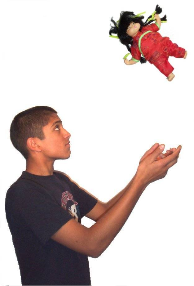 Boy throwing doll.jpg