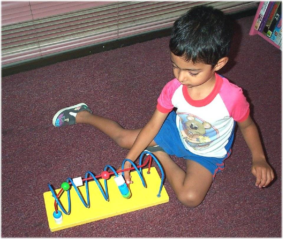 Child playing on floor3.jpg
